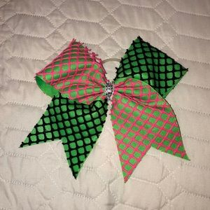 green, black, and pink cheer bow